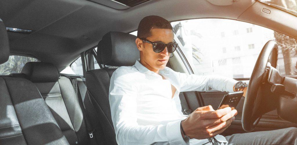 man in car on phone